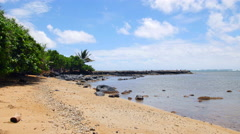 Molokai beach lined with boulders in Hawaii Stock Footage