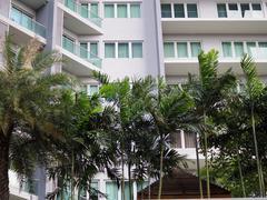 Condominium with garden, urban trees Stock Photos
