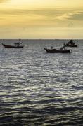 Stock Photo of Fishing boat floating on sea