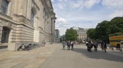 Walking besides the Reichstag building in Berlin Stock Footage