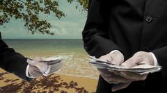 Travel expenses concept, Businessman make money from beach - stock photo