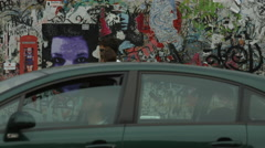 The Berlin Wall with paintings and graffiti Stock Footage