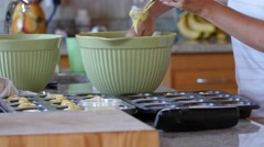 Woman makes cupcakes in the kitchen Stock Footage