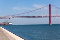 The 25 de Abril Bridge is a suspension bridge on river Tejo, Lisbon. Stock Photos