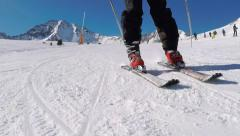 Skiing close up skis & ski boots piste fast technique & skier angulation Stock Footage