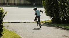 a little boy learning to roller skate - stock footage