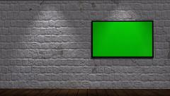 Virtual Studio - brick wall background with animated green screen monitor - stock footage