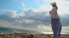 Romantic female silhouette on sunny beach, tender femininity image, wind blowing - stock footage