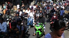 Traffic moves slowly along a busy road in Ubud. Island Bali, Indonesia - stock footage