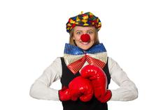 Stock Photo of Pretty female clown with box gloves isolated on white