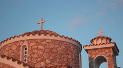 Cross on church roof against blue cloudless sky, architecture, religion, prayer Stock Footage