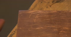 Man's Hands Are Grinding The Edges of Copper Plate Preparing it to Make Stock Footage
