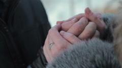 Girls warms hands boyfriend, frozen in the cold Stock Footage