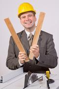 cheerful man beside a circular saw - stock photo
