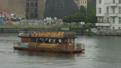 Boat floating close to the Berlin Wall Stock Footage
