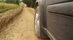 Offroader Rides on a Dusty Dirt Road Stock Footage