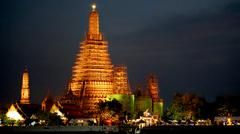 Temple of the dawn, Wat Arun Bangkok landmark at dusk - stock photo