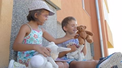 Brother and sister playing with teddy player Stock Footage