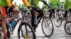 Abstract biking tournament at start line, shot of a group of race cyclists - stock photo