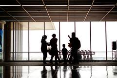 people silhouettes at airport - stock photo