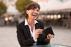 Laughing vivacious woman making a payment Stock Photos
