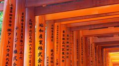 Red torii shrine at Fushimi Inari temple, Kyoto Japan Stock Photos