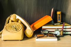 The phone and stationery on desk.. - stock photo
