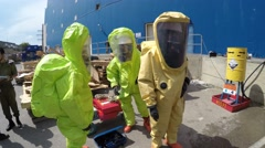 Firefighters prepare for sealing leak of hazardous corrosive toxic materials Stock Footage