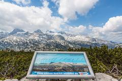 Stock Photo of Dachstein mountains with info sign