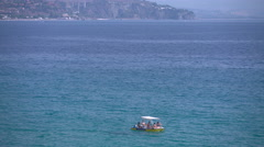 Family on small boat in Calabria, Italy - stock footage