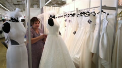 Many wedding dresses in white Bridal salon. Stock Footage