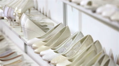 Lots of white wedding shoes on the shelves in the Bridal salon. Stock Footage