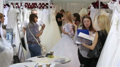 A young woman chooses a wedding dress Bridal salon. Stock Footage