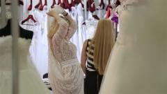 A young woman tries on a wedding dress Bridal salon. - stock footage