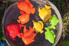 fish and other toy in water - stock photo