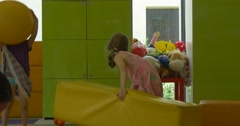Two Little Blonde Girls Friends are Playing with Yellow Matws Throw the Mates Stock Footage