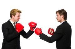 Pair of businessmen boxing on white Stock Photos