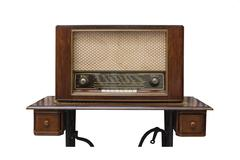 The classic wooden radio on the table made from sawing machine Stock Photos