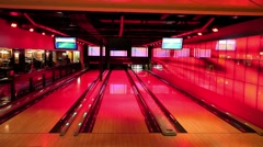 Bowling game at the night disco club and restaurant Stock Footage