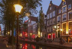 Illuminated streetlights on Amsterdam canal street, Netherland Kuvituskuvat