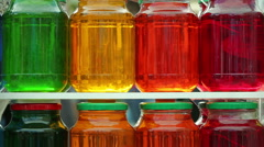 Lots of glass jars with colorful fruit compote in the window of a grocery store. - stock footage