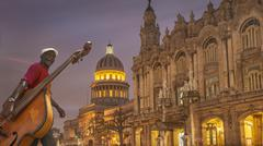 Hispanic musician carrying upright bass in city, Havana, Cuba Kuvituskuvat