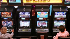 People and money gambling machine at the casino Stock Footage