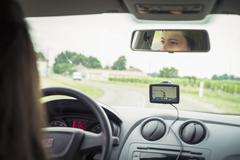 Caucasian woman driving car with GPS navigation Stock Photos