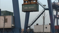 Shipping container, unloaded in port, China Stock Footage