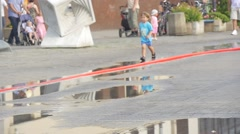 The Boy Dressed in a Blue T-shirt And a Blue Shorts Runs Along the Street. Stock Footage