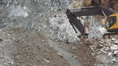 Backhoe removing gravel and rocks, rockslide Stock Footage