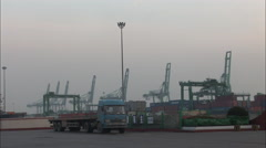 Empty truck leaving Tianjin port, China Stock Footage