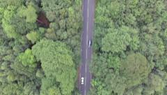 Aerial view of a traffic driving along the forest Stock Footage