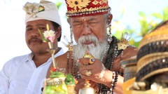 Old Brahmin conducts religious ritual on the beach, Ubud, Bali , Indonesia Stock Footage